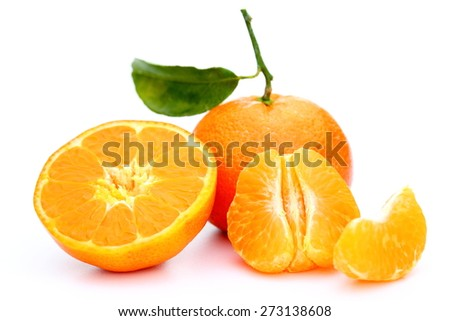 different pieces of a clementine on white background