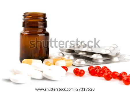 different pills closeup on white background