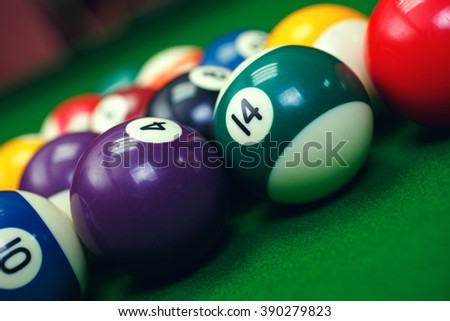 Different points of view billiard balls on a blue pool table.