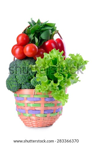 different ripe vegetables in basket isolated. large depth of field of the frame - stock photo