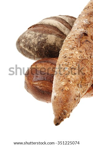 different rye and white flour bread loaf with french baguette isolated on white background
