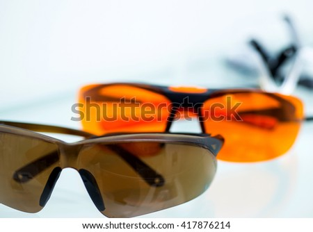 Different safety glasses on white table in dentist's office. - stock photo