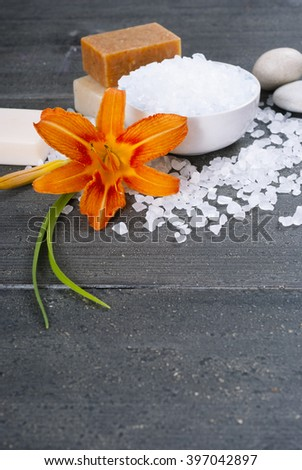 different salt soaps and bath salt with lily flower