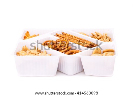 Different salted crackers in box on white background. - stock photo