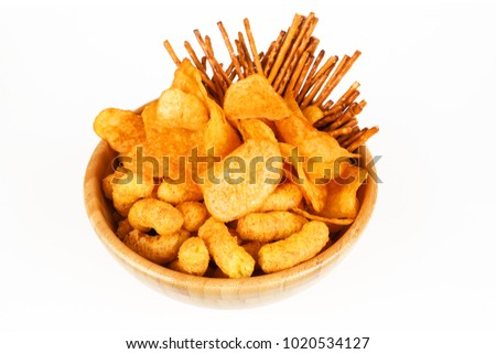 different salty snacks in a bowl and white background