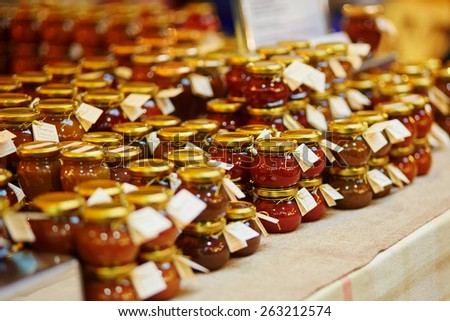 Different sauces, mustards and tapenades on farmer agricultural market - stock photo