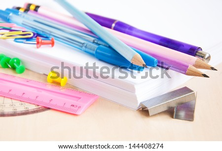 different school office supplies on the table
