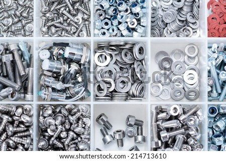 Different Screws and other Parts sorted in a box (close-up shot) - stock photo
