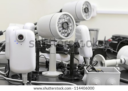 different security cameras pre-wired - stock photo