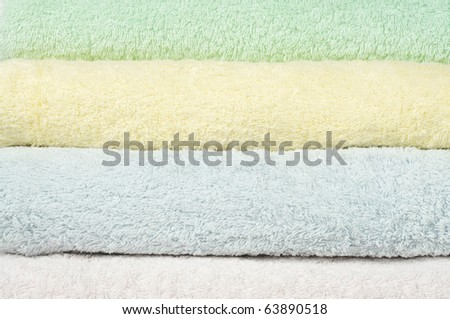 Different shades of  towels stacked on each other - stock photo