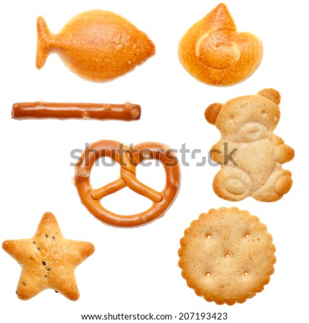 Different shaped crackers and pretzels on white background