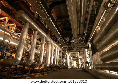 different size and shaped pipes and valves at a power plant - stock photo