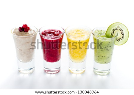 different smoothie with fruits and berries on white background - stock photo