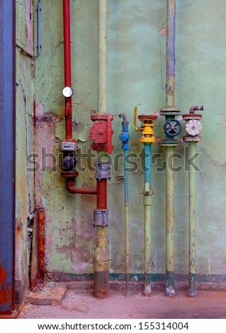 different sort of pipes in a factory - stock photo
