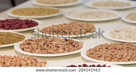 Different sorts of beans arranged on plates