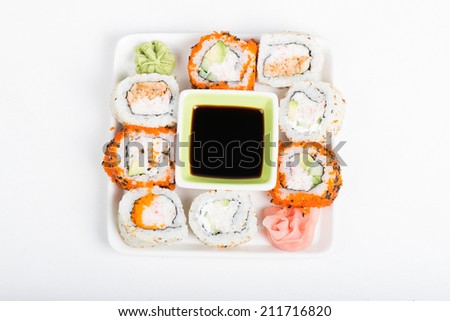 Different sorts of sushi on the plate, top view - stock photo