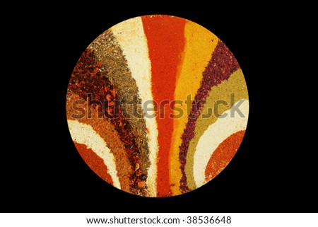 Different spices laid in the form of dispersing lines on a black background - stock photo