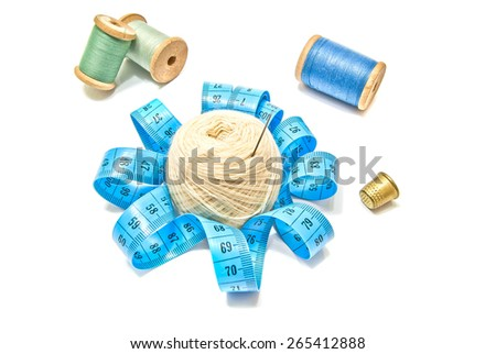 different spools of thread and yarn closeup on white - stock photo
