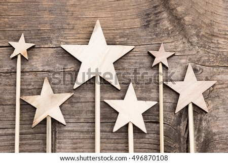 Different stars made of wood on a wooden background