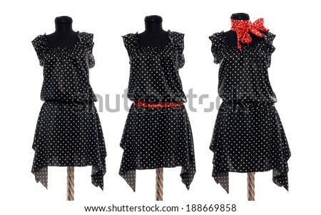 Different styling of a polka dots dress on mannequin. Woman summer outfit on three tailor's dummies isolated on white background. - stock photo