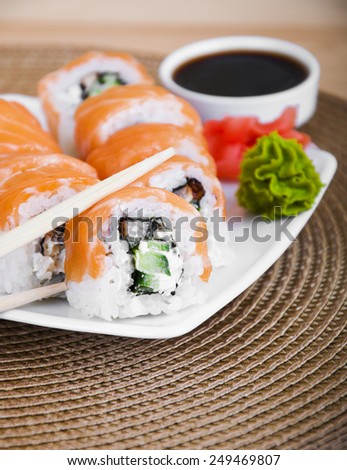 Different sushi rolls,wasabi and ginger on a plate