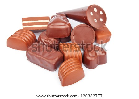 Different sweet chocolate candies isolated on white background, food photo