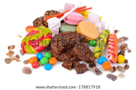 Different sweets isolated on white - stock photo