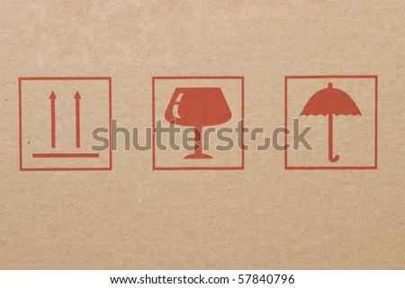 different symbols from cardboard box, information labels - stock photo