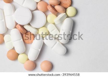 different Tablets pills capsule heap mix therapy drugs doctor flu antibiotic pharmacy medicine medical - stock photo