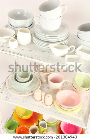 Different tableware on shelf, close up