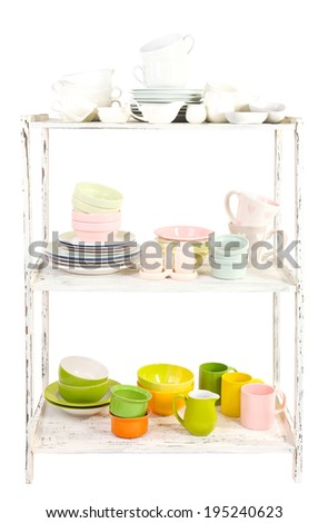 Different tableware on shelf, isolated on white
