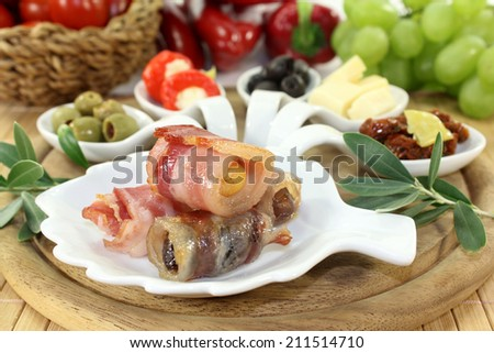 different tapas in Serving spoon on a wooden board - stock photo