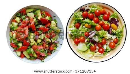 Different tasty vegetarian salads with red and yellow cherry tomatoes, arugula, cabbage and lettuce isolated on white