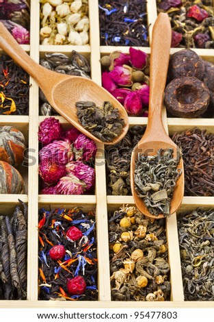 different tea types : green, black, china, floral , herbal  in a wooden box with bamboo spoons - stock photo