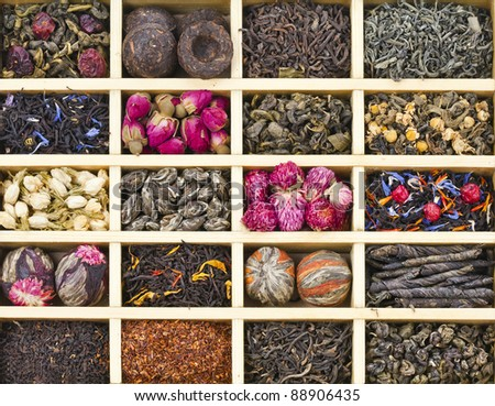 different tea types : green, black, floral , herbal in a wooden box background - stock photo