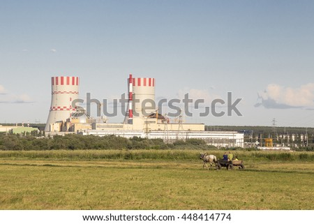 Different technologies: atomic power plant versus horse cart - stock photo