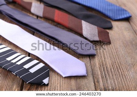 Different Ties on wooden planks background - stock photo