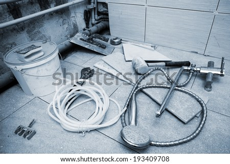 different tools for repair in the bathroom - stock photo