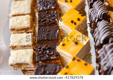 Different type of cakes with chocolate and vanilla - stock photo