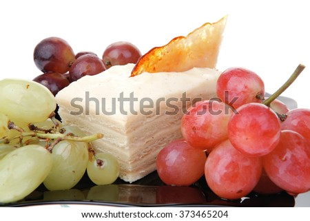 different type of grapes and cream cake on black - stock photo