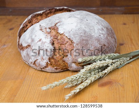 Different types of bakery products such a a loaf of bread, pretzel, whole grain bread and buns - stock photo