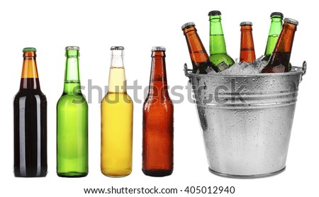 Different types of beer in bottles, isolated on white - stock photo