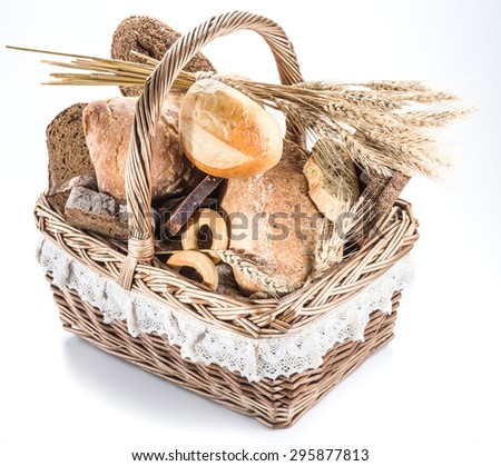 Different types of bread in the basket on a white background.