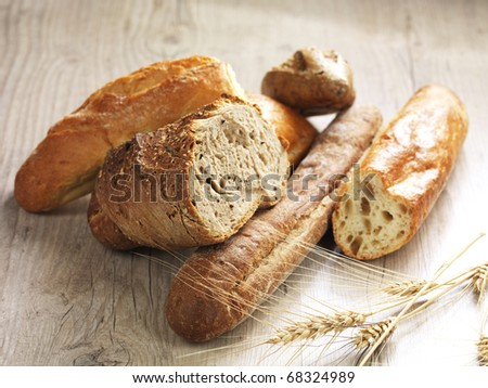 different types of bread on a wooden surface