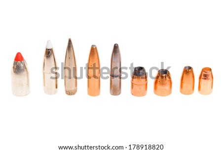 Different types of bullets, both pistol and rifle for hunting and target shooting - stock photo