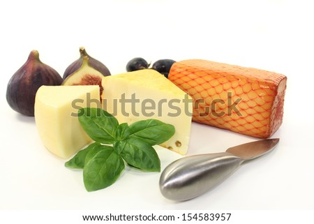 different types of cheese against white background
