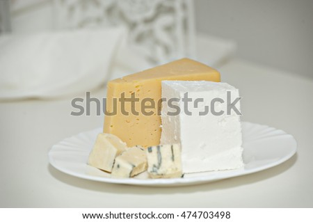 Different types of cheese on a plate