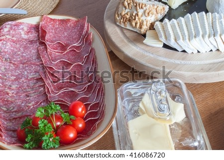 Different types of cheese on the table. Homework healthy breakfast. Diet food. Breakfast for children. Well-laid wooden table.  - stock photo