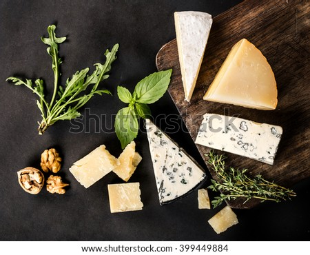 Different types of cheeses on black - stock photo