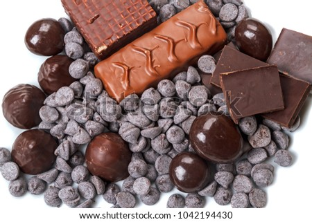 Different types of chocolate and candies on white background